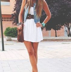 love this outfit. short white dress with belt at waist, sleeveless denim vest