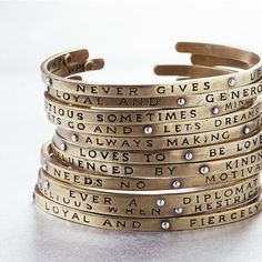 Planetary Traits Cuffs. One for every month of the year, a personality trait best fitting the astrological sign of the wearer. OR wear the sentiment that best befits you (the stars don't ALWAYS get it right?)   http://www.waxingpoetic.com