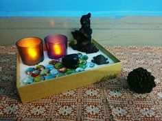 A Zen inspired mini-garden with Tea Lights, Sand and Stones.