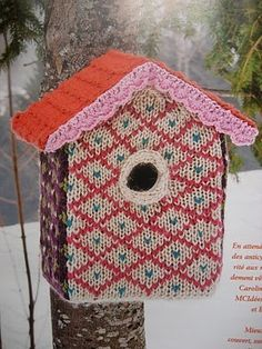 I love the knitted cover on this birdhouse!