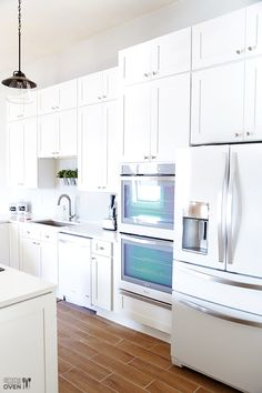 White On White Kitchen   Beautiful White Appliances   A Sleek And Modern  Look   Fridge Next To Double Wall Oven