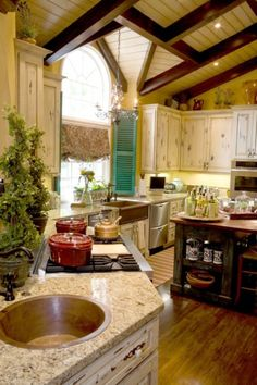 I want to cook in this kitchen!  Perfect combination of rustic and dark wood love the shutter accent too.