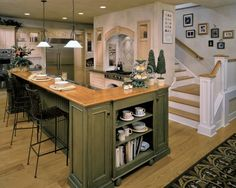 lovely kitchen with green cabinetry
