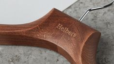 """Visual Identity for Helbers by Only Studio """"We worked with Paul Helbers to distil his brand into a harmonious identity. The Helbers wordmark set in a bespoke version of Meta Serif balances the two contrasting worlds of the contemporary the. Corporate Identity Design, Brand Identity, Visual Identity, Wooden Logo, Brand Presentation, Suit Hangers, Coat Hanger, Blog Design Inspiration, Corporate Fashion"""