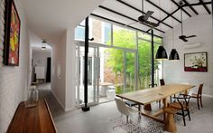 Modern Tube House by MimANYSTUDIO + REAL • Design Father