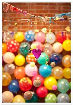 Or put together a balloon wall. | 35 Incredibly Fun Ways To Add Color To Your Wedding