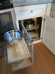 Martha Stewart's kitchen - Another rack is in position to pull out.  These racks are great for holding bowls, pots, and other cooking utensils.