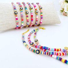 Evil Eye Bracelet, Rainbow Heishi Bracelet, Polymer Disc Bead, Beach B –#evileye #evileyes #evileyebracelet #evileyejewelry #adjustablebracelet #greekjewelery #nazarboncuk #nazarbeads #greekevileye #bracelet #banglebracelet #cuffbracelet #polymerbracelet #heishibracelet #goldbracelet Evil Eye Jewelry, Evil Eye Bracelet, Beach Bracelets, Bangle Bracelets, Seed Bead Jewelry, Beaded Jewelry, Greek Evil Eye, Polymer Clay Beads, Adjustable Bracelet