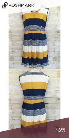 The Clothing Co elastic waist midi dress size L The Clothing Co midi dress size large. Pleated skirt with 5 button detail on each shoulder. Has small belt threads on sides, but use your own skinny belt. Polyester with silky soft lining. The Clothing Co.  Dresses Midi