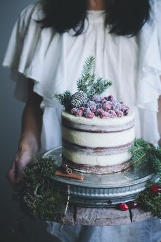 Soft gingerbread cake with cream cheese frosting and sugared cranberries by Linda Lomelino of Call me cupcake