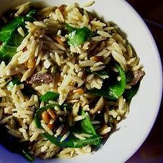 Refreshing Summer Orzo Salad Recipe with chicken broth, orzo pasta, butter, extra-virgin olive oil, minced garlic, dried basil, dried thyme, crushed red pepper flakes, pinenuts, pitted kalamata olives, capers, feta cheese, fresh spinach leaves, lemon juice