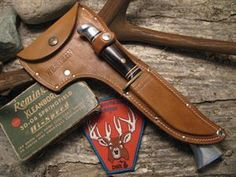 Show details for Western Axe Knife Combo Set Vintage 1960s  Mint  with Mint sheaths.