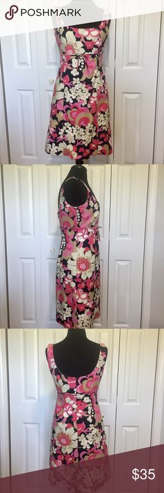 J.Crew sleeveless empire waist floral dress This dress is in good condition without any rips or stains. Fully lined with back zip. Says to dry clean, but did fine in a dress bag on delicate wash. Measurements taken flat and in inches. Armpit to armpit 181/4. Empire waist under bust line 15. Top of shoulder to empire waist 121/2. Center front to hem 29. Center back to hem 27. J. Crew Dresses
