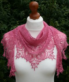 Another way to drape the Sweet Dreams shawl by Boo Knits -- this uses a size 7/8 needle with fingering yarn. You have to buy an ebook of 5 patterns to get this one, but it does look intriguing.