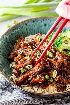 Slow Cooker Asian Caramel Pulled Pork is crazy tender smothered in the most addicting savory, sweet and spicy sauce infused with coconut milk, soy sauce, sweet chili sauce, sriracha, ginger and garlic. This pork is amazing with rice/veggies or in salads, wraps, tacos, etc!