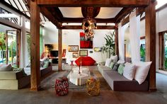 """Bali, Indonesia 2 of 12   The listing describesthis home in Bali, Indonesia, as """"whimsical"""" and """"vibrant,"""" and the photos easilyback up those claims. Spotted: a chandelier made of pots and pans, neon signage, a light-up rainbow, a lips sofa, and (of course!) a human-sized nest with giant plushy eggs."""