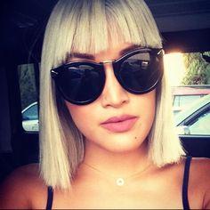 trendy blonde blunt bob cut with sun glasses