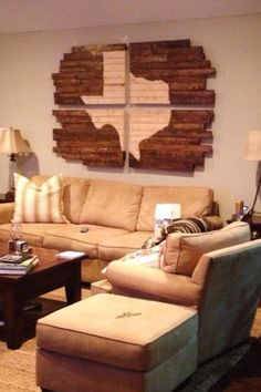 DIY inspiration: take wood slabs, stain around a silhouette (home state, etc.) for easy wall art (as large or as small as you desire..would not have to be separated into four parts like this)