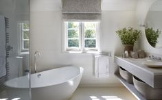 outside mount gray roman shade | minimalist | floating bathroom vanity | home staging ideas | soaking tub | towel heating rack | home staging ideas | master bathroom design