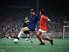 Chelsea's Peter Osgood is challenged for the ball by Manchester United's George Best, circa 1968.