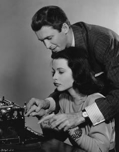 """Hedy Lamarr and James Stewart. The irony of him """"helping"""" her use a typewriter though, when she was so highly educated, is not lost on me."""