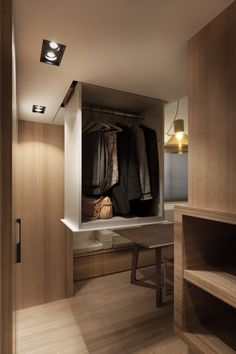 Storage, of course, is always an issue in a home this small. The designer has cleverly built storage into otherwise unused spaces in the ceiling. These sliding wardrobes pull down when needed and fold completely out of the way when not. The same is true of the hidden meditation pool on the lower level that gets sealed up by a natural wood plank when not in use.