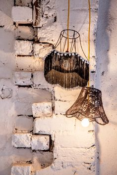 Add tassels, pom poms, lace to old wire lamp shades. Pop a hanging light set inside and...perfection!