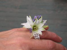 A flower ring~alternative to a traditional corsage.~ Stems Flower Shop