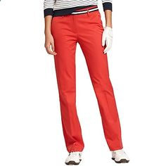 Tommy Hilfiger Golf Collection womens golf pants. Essential warm weather pants, designed for sports but great for everything else too. Youll bless them on sticky days as you look and feel as cool and crisp on the 18th green as on the 1st. In our light, cool, moisture-wicking TH Tech stretch fabric, in a solid micro twill. Waistband with striped grosgrain ribbon appliqu? and hidden hook close. Front zip fly. Angled front pockets. Back welt pockets, one with Tommy flag embroidered just a...