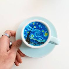 A South Korean barista makes these beautiful coffee art.