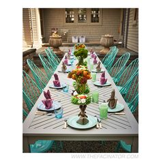 The children's table was set outdoors in the courtyard.  The napkins were folded to look like bunnies.