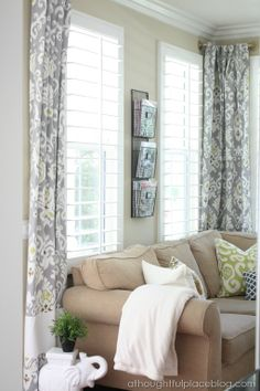 Keep an eye out for beautiful drapes at HomeGoods. If they are too short, like these were, you can follow a tutorial to lengthen them. And a wire rack mounted to the wall is a great place to store magazines. #happybydesign #sponsored #homegoodshappy