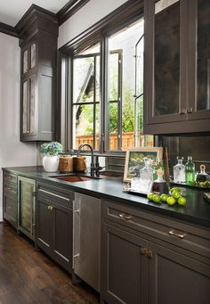 Mirrored bar backsplash and black quartz countertops keep rich antiqued mirrored cabinet doors from weighing down this elegant butler pantry. Kitchen Interior, Cabinet Doors, Cabinet, Dark Home Decor, Bar Countertops, Grey Cabinets, Mirrored Cabinet Doors, Kitchen Style, Kitchen Design