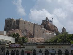 'Uchi Pillayar Kovi'l [Rockfort Temple], in Tiruchirapalli, Tamil Nadu, India, is a 7th-century Hindu temple, one dedicated to Lord Ganesh. The Rock Fort temple stands 83m tall perched atop the rock. The smooth rock was first cut by the Pallavas but it was the Nayaks of Madurai who completed both the temples under the Vijayanagara empire.