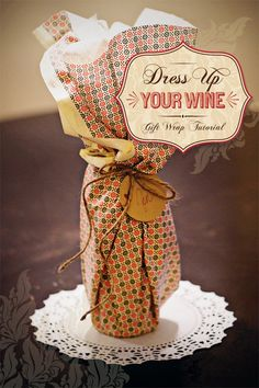 DIY Tutorial: Wine Packaging {Gift Wrap Idea} that is perfect for any hostess gift for a dinner party, holiday event, or even new years eve!