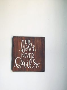 His love never fails sign hand painted on stained wood makes for great rustic home decor!   Specs: *This sign is approx. 8 tall and 7 wide *All