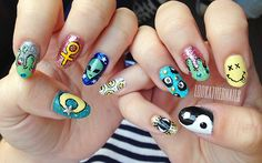 90s grunge glitter nail art! Featuring alien, magic 8 ball, smiley face, feminist, slime, yin yang, and moon designs. by LookAtHerNails