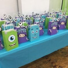 Monsters Inc Birthday Party Ideas/ Monsters Inc party favor bags/ goodie bags/ goody bags/ Monsters Inc gift bags/ treat bags/ DIY Monsters Inc party decorations/ ideas/ Monsters Inc printables/ Monsters Inc birthday cake/ banner