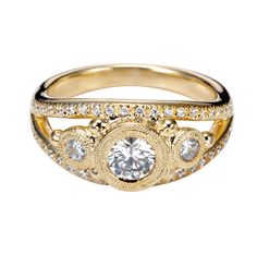 a non traditional engagement ring in yellow gold.
