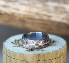 Elk wedding band featuring a 10k gold inlay.