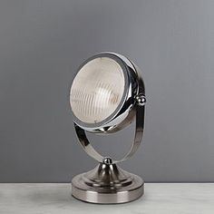 Featuring a contemporary satin chrome finish, this headlight table lamp is unique in its design. This stylish lamp will create a bold decorative statement in any room and will provide an additional source of bright light where it's needed. Silver Table Lamps, Bedside Table Lamps, Guest Room Office, Desk Light, Guest Bedrooms, Soft Furnishings, Chrome Finish, Bulb, Lights