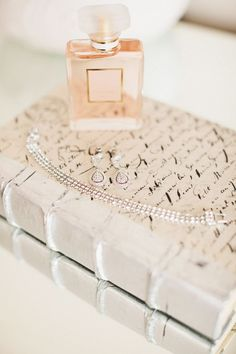 bd2d72e0c6b7 Pretty still-life. Love the Dior bottle on top of the poetic journal.