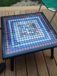 Made this for Joey! Beer cap table. Shay built the table, I did the caps.