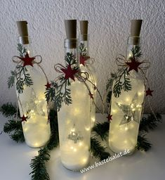 dekoration Lichterglanz With a few empty wine bottles, a couple of LED fairy lights and Christmas Wine Bottles, Lighted Wine Bottles, Wine Bottle With Lights, Wine Bottle Lighting, Halloween Wine Bottles, Wine Bottle Centerpieces, Christmas Centerpieces, Christmas Decorations, Christmas Projects