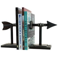 Set of 2 Cast Metal Bookends Industrial Chic Style Functional and Decorative Designed in Memphis Add a little western flare to your bookshelf or sofa table with the Arrow Bookends. Made of metal and m