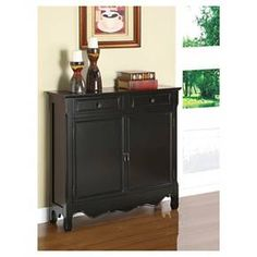 The Black Console has a sleek and simple design. The decorative curved bottom adds an extra touch of drama to the piece while the black finish is sure to fit into any home décor. The console opens with two doors to reveal storage space with interior, fixed shelf. This is the perfect piece to add to any entryway, hall, bedroom or living area. Fully Assembled.