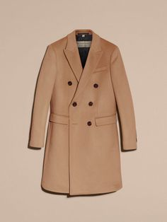 A sharply tailored Burberry camel coat woven with a blend of wool and cashmere for softness and lightness with a brushed, downy texture.