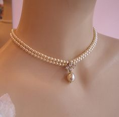 A bridal necklace , full of chic and vintage style, features tiny ivory cream Swarovski Pearls connected to a Luxe rhinestone vintage pendant and a central vintage cream Ivory pearl is dangle below. The shape is vintage Victorian and fits so beautiful on your neck. A perfect necklace