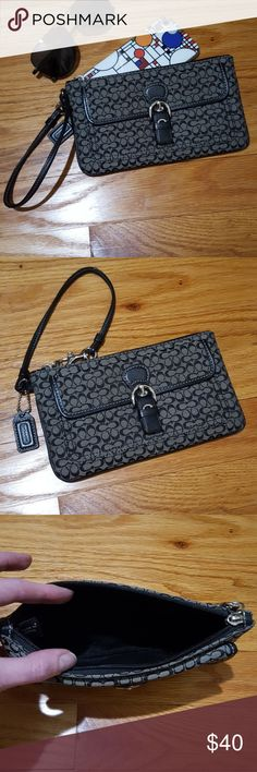 "Coach Logo Signature Fabric Wristlet Black & Gray Coach logo signature fabric wristlet. Small buckle with outside pocket, full top zip interior pocket. Coach leather logo tag, strap, and leather trim. Silver hardware. Excellent used condition with some wear on one corner (last pic). Fits cell phones such as iphone 7. Measures 7.75"" x 4.5"". Wrist strap 6"" long. Coach Bags Clutches & Wristlets"