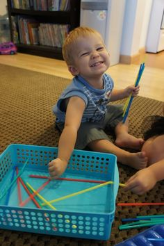 This blog has several great ideas on ways to keep your toddler busy while you are busy with other things.
